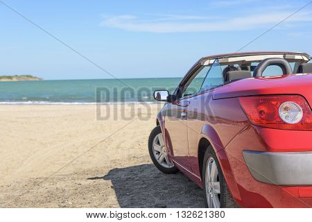 BURGAS, BULGARIA - MAY 1: Woman in the car Renault Megane Cabrio on the sand beach on May 1, 2016 in Burgas, Bulgaria.