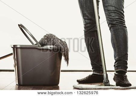 Closeup Of Human Cleaning Mopping Floor.