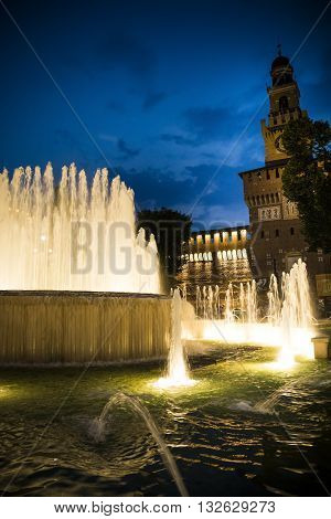 Milan fountains and medieval palace by night