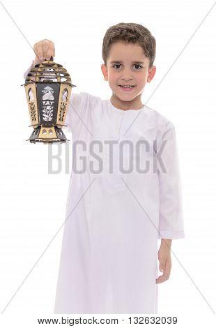 Happy Boy With Lantern In White Djellaba Celebrating Ramadan