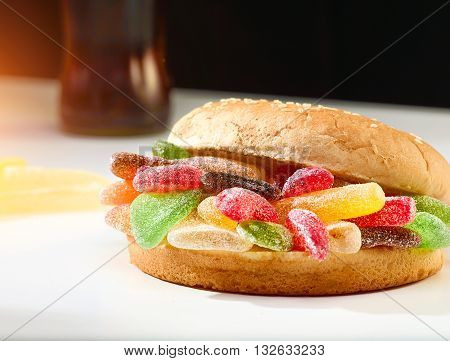 Delicious homemade Hamburger made of colorful gummy sweets - the perfect snack for unhealthy teeth destruction