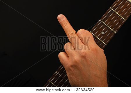 Man Hand On Guitar Neck Showing Finger On Black