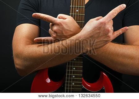 Hands With Red Guitar And Devil Horns On Black