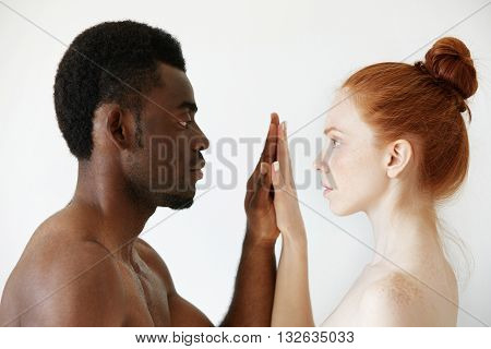 Interracial Multi-ethnic Couple. Intimate Portrait Of African Male And Pretty Caucasian Female With
