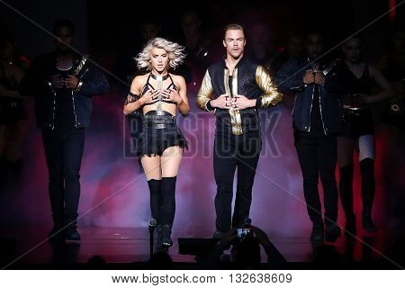 NEW YORK-JUL 9: Julianne Hough (L) and Derek Hough perform on stage during the Move Live On Tour at Radio City Music Hall on July 9, 2015 in New York City.