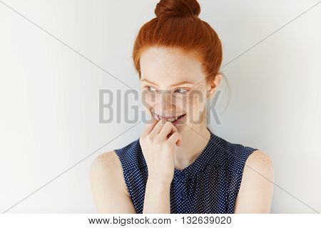 Studio Portrait Of Attractive Young Caucasian Redhead Female Looking Away With Cute And Shy Smile. P