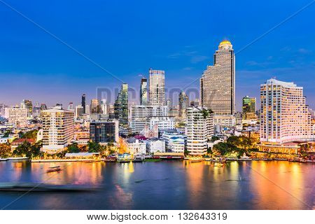 Bangkok, Thailand skyline on the Chao Phraya River. poster