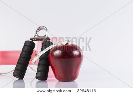 Fitness background with bottle of dumbbell handgrip and apple