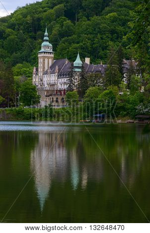 Northern front of Lillafured palace (Miskolc Hungary). Lake Hamori in foreground mountains covered with forest in background.