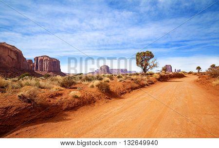 red dirt road in rocky desert scenery