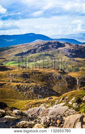 Undulating Green, Purple And Yellow Rocky Landscape In  Ireland
