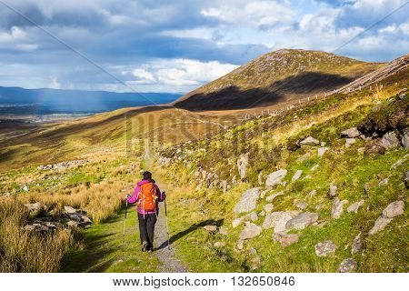 Female Hiker Hiking In The Mountains In Ireland