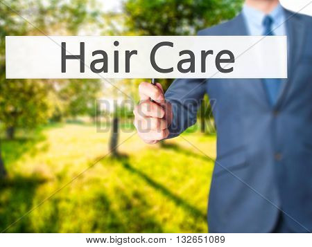 Hair Care - Businessman Hand Holding Sign