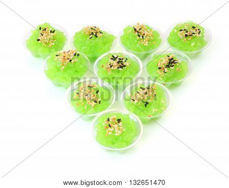 Triangle of pandanus flavored sweet translucent gelatinous rice.