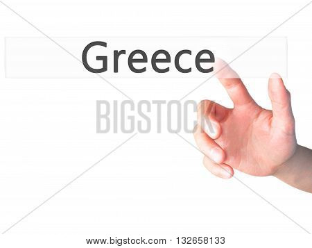 Greece - Hand Pressing A Button On Blurred Background Concept On Visual Screen.