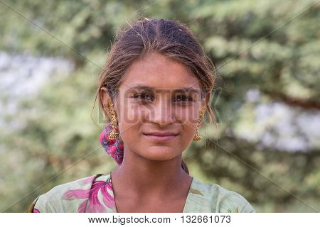 PUSHKAR INDIA - OCTOBER 27 2014: Unidentified girl at the attended the annual Pushkar Camel Mela. This fair is the largest camel trading fair in the world.