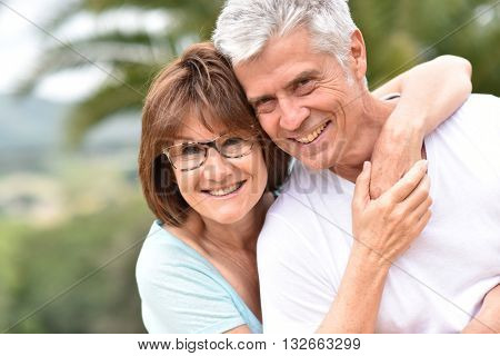 Portrait of happy senior retired couple