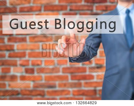 Guest Blogging - Businessman Hand Pressing Button On Touch Screen Interface.
