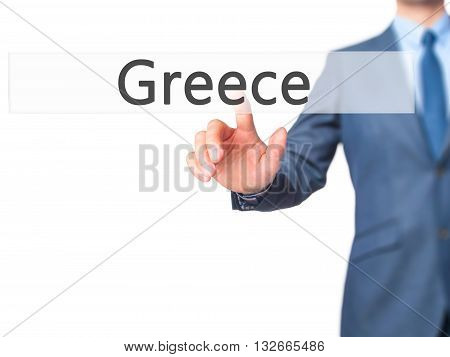 Greece - Businessman Hand Pressing Button On Touch Screen Interface.