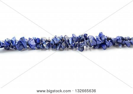 Gemstone natural lapis lazuli on white background, beads.