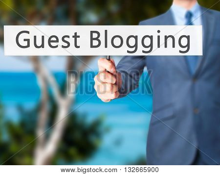 Guest Blogging - Businessman Hand Holding Sign