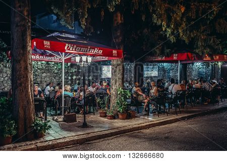 Trebinje Bosnia and Herzegovina - August 27 2015. People sits in restaurant located on the Old Town of Trebinje
