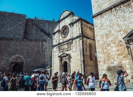 Dubrovnik Croatia - August 26 2015. Tourists walks on Stradun street n front of Saint Saviour Church on the Old Town of Dubrovnik