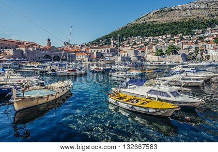 Dubrovnik Croatia - August 26 2015. Boats in Old Town Harbour in Dubrovnik. View with Revelin Fortress and Dominican Monastery