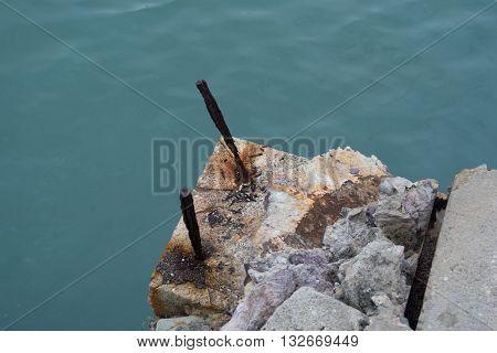 Rust Iron On Cement Pillars Disintegrated.