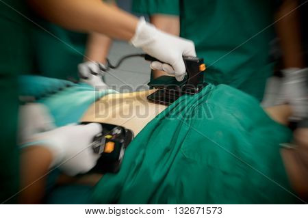 Defibrillator practice on a CPR with motion blur