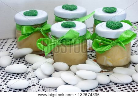home made weddings favors on fabric background