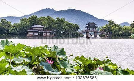 Hangzhou, China - August 14, 2011: Scenic view of Yudai Bridge On West Lake. West Lake has influenced poets and painters throughout Chinese history for its natural beauty and historic relics.