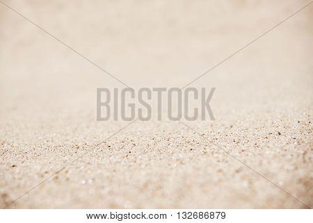 Sand on the beach background, tilt-shift technique