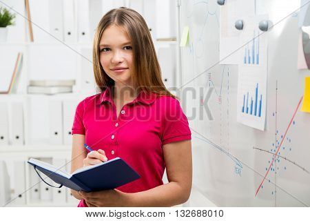 Woman Writing In Diary