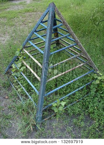 Old pyramid of steel rods for children's games.