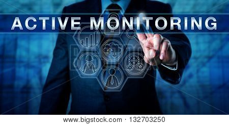 Managed service provider is touching ACTIVE MONITORING on a visual control display. Information technology metaphor and business concept for minimizing risk via remote monitoring and support.