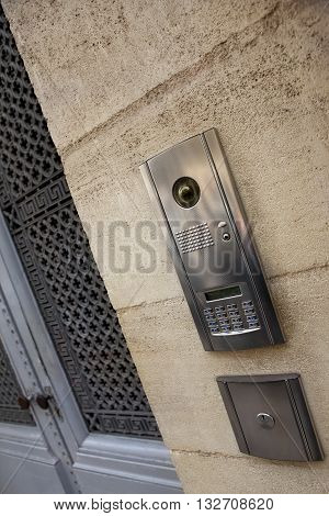 Modern intercom on a stoned facade of a French mansion