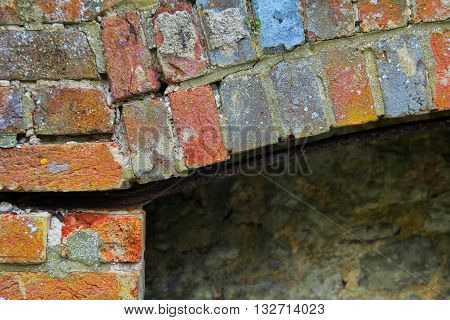 A brick pattern on an old derelict fireplace