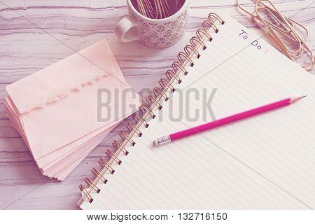 Over head view of to do list on feminine desktop