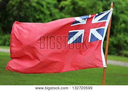 The British Merchant Navy Red Ensign flag for civilian fleet. The Red Ensign or