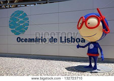 LISBON, PORTUGAL - JUNE 16, 2015: Vasco mascot in front of the facade of the Lisbon Oceanarium modern building, Portugal