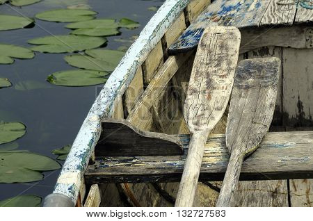 Wooden Small Boat And Paddles