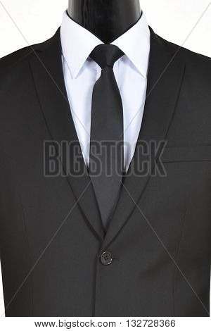 Closeup of a mannequin wearing a tie and suit