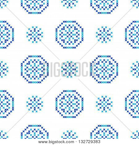 Isolated seamless embroidered texture with abstract blue ornaments. Snowflakes. Winter patterns for cloth. Embroidery.Cross stitch