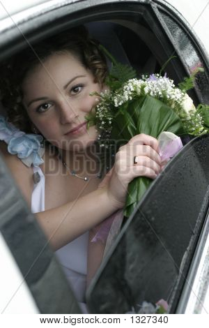 Young Bride In A Limousine