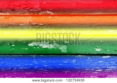 wooden fence as a background with rainbow colors for gay pride