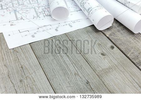 Floor Plan With Architectural Blueprints On Wooden Desk