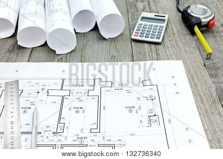 Contractor Work Tools With Floor Plan On Gray Wooden Boards