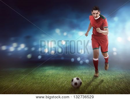 Football Player Dribbling Ball