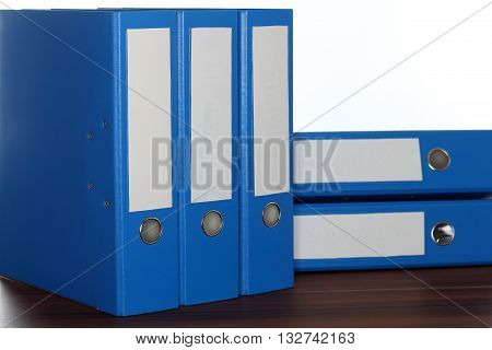 wooden board with some blue file folders
